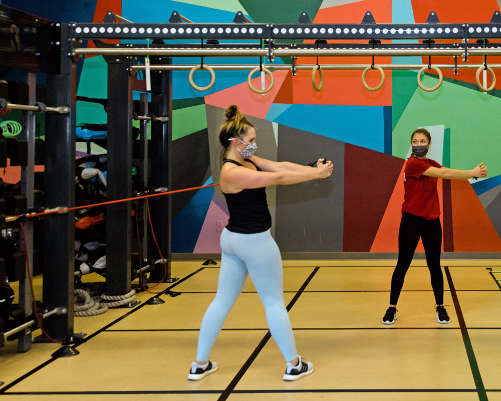 Women with Personal Trainer performing exercises